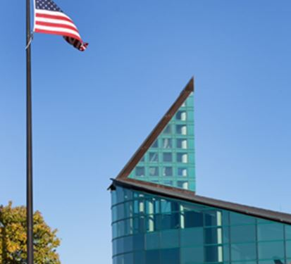 Glass Building With Flag Waving